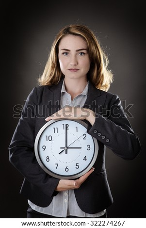 business woman holding a wall clock