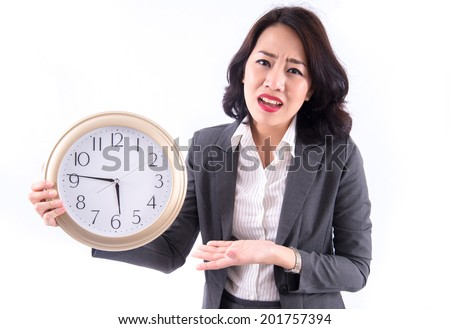 business woman holding an office clock isolated on a white background. Time concept