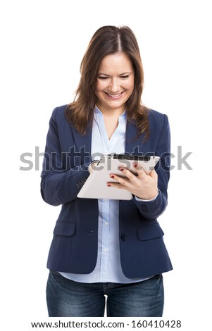 Business woman holding and working with a tablet, isolated over a white background - stock photo