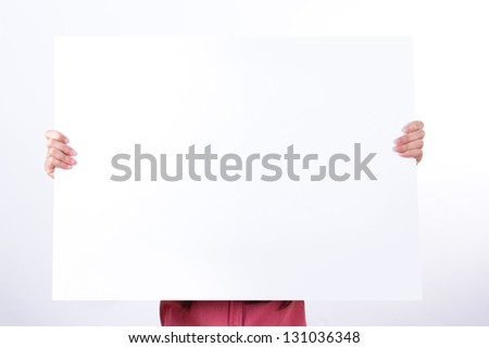 Business woman holding big blank white poster board to her face, isolated on white background. - stock photo