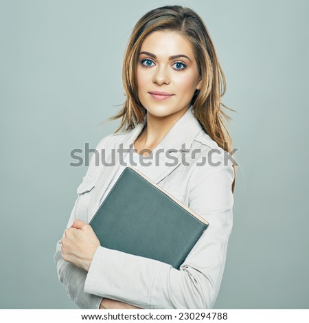 business woman holding book. young female employee portrait. studio isolated. - stock photo
