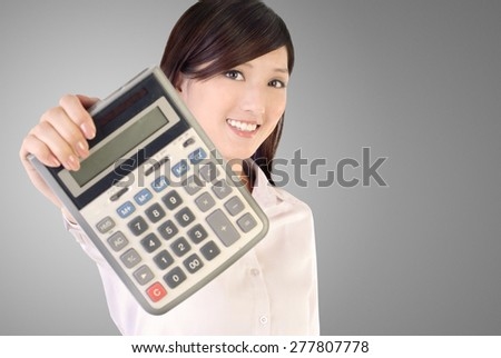 Business woman holding calculator on white background, focus on face. - stock photo