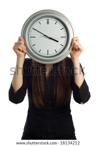 Business woman holding clock over face isolated on white - vertical