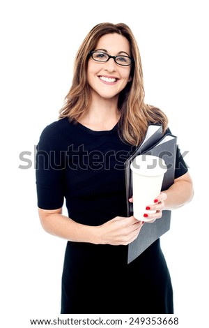 Business woman holding folder and disposable cup - stock photo