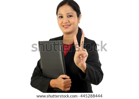 Business woman holding folder and making victory sign