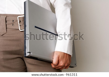 business woman holding laptop - stock photo