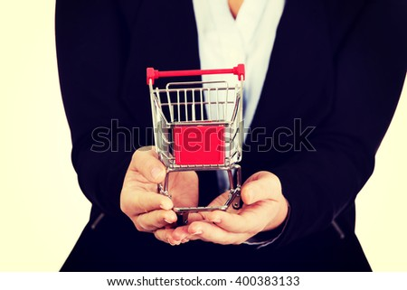 Business woman holding shopping cart