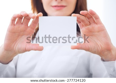 business woman holding showing blank sign. Close-up