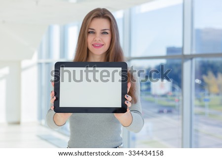 business woman holding tablet in hands - stock photo