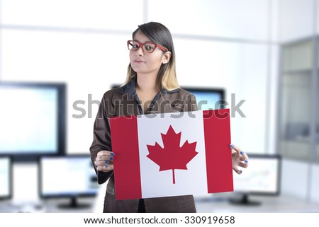 Business Woman Holding The Canadian Flag - stock photo