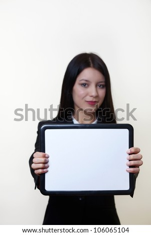 business woman holding up a small clean white board ready to write something on