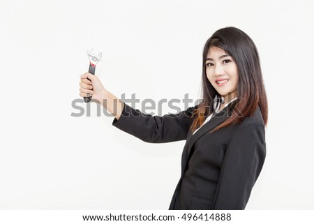 Business woman holding wrench to fix on white background.