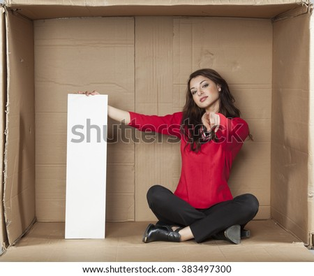 business woman holds a copy space and pointing at you