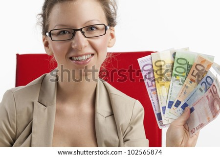 Business woman holds fan of money - stock photo