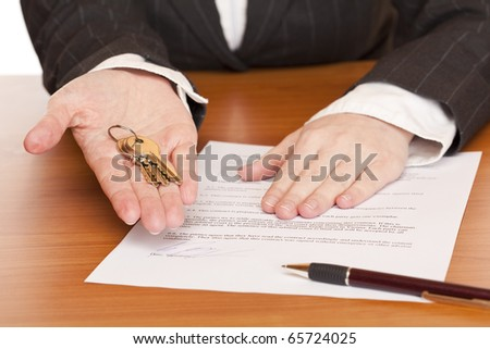 Business woman holds key and contract in hands. Isolated on white background.