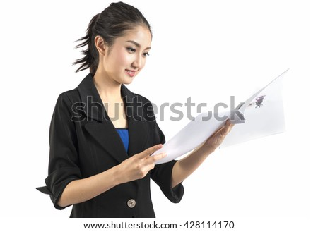 Business woman in a suit and skirt looks inspect document - stock photo