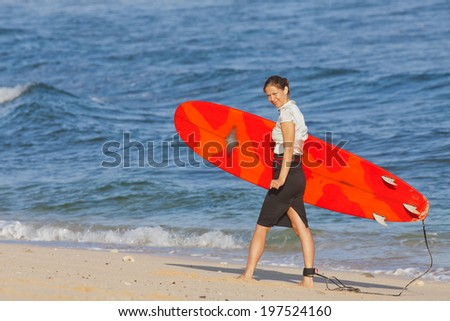 Business woman in an active vacation for try to surfing - stock photo