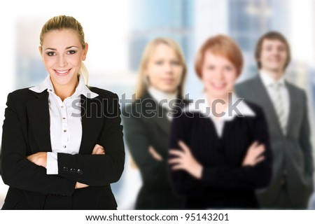 Business woman in an office environment with team - stock photo