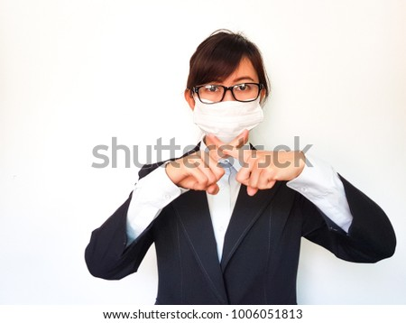 Business woman in black suit has sickness and making stop gesture, standing on a white background, Health care concept.