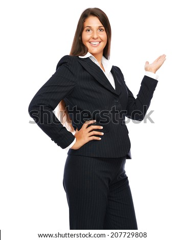 Business woman in black suit is showing empty space.   Isolated on a white background.