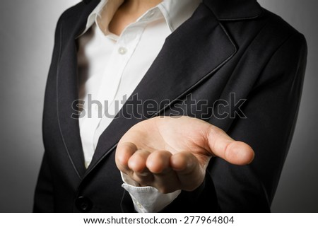 business woman in black suit open palm hand for show something. - stock photo