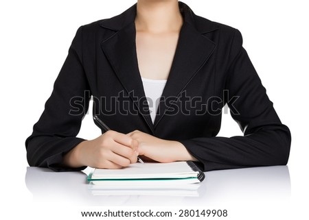 Business woman in black suit writing notebook on table isolated on white background. - stock photo