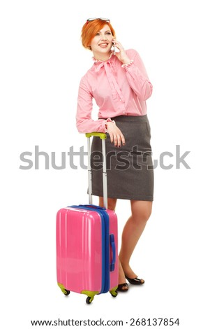 Business woman in business trip with a suitcase on wheels speaking mobile  and smiling , isolated on white background - stock photo