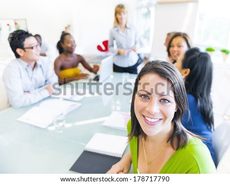 Business woman in conference with associates - stock photo