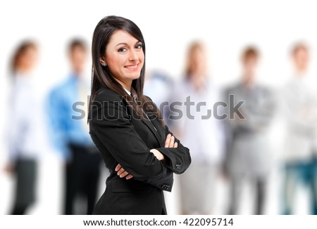 Business woman in front of her team - stock photo