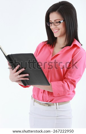 Business woman in glasses with a notebook - stock photo