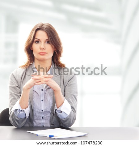 Business woman in office isolated on white - stock photo
