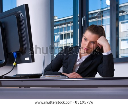 business woman in office looking at computer