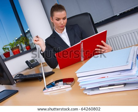 business woman in office sitting at the desk