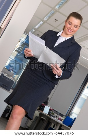 business woman in office with documents in her hands