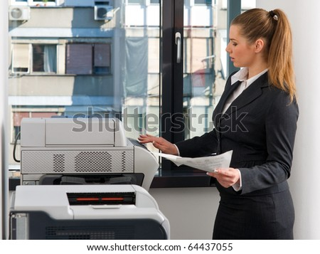 business woman in office working on printer