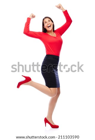Business Woman in red celebrating doing the Winner dance - stock photo