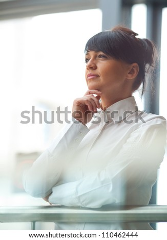 Business woman in shopping mall. - stock photo