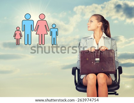 Business woman in skirt, blouse and jacket, sitting on chair and holding briefcase imagines family. Against background of sky and clouds - stock photo