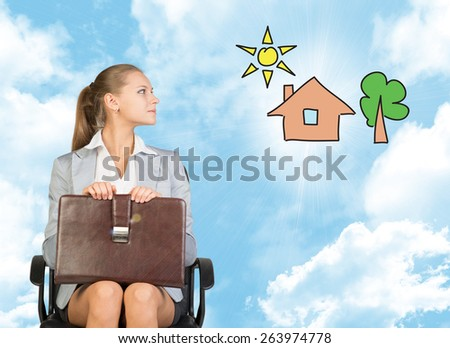 Business woman in skirt, blouse and jacket, sitting on chair imagines house with tree. Against background of blue sky and clouds - stock photo
