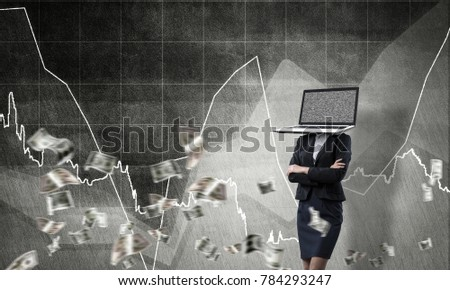 Business woman in suit with laptop instead of head keeping arms crossed while standing against flying dollars and analytical charts drawn on wall on background. 3D rendering.