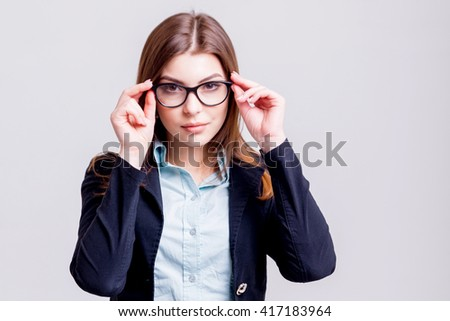 Business woman in the office on grey background
