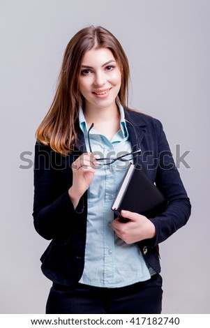 Business woman in the office on the gray background