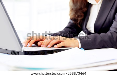 Business woman in the office, work at the computer, close-up. - stock photo