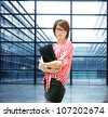 Business woman indoor, closeup portrait of Asian inside building of office - stock photo