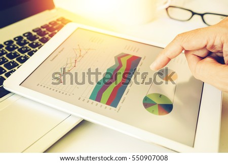 business woman investment consultant analyzing company annual financial report balance statement working with documents graphics. Concept picture of economy, market, office,money and tax.