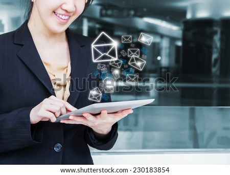 Business woman is checking email by digital tablet
