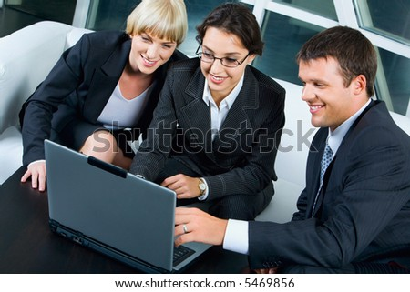 Business woman is explaining the correct way of analysis to her colleagues in  the room - stock photo