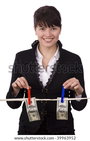 Business woman is hanging hundred dollar bills on clothesline. Girl laundering money.  Businesswoman stash kept secret from other..