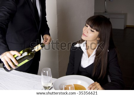 Business woman is ordering wine at a fine restaurant