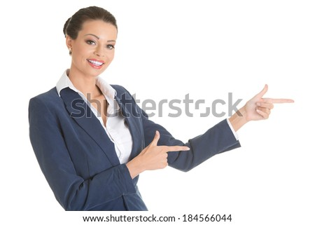 Business woman is pointing aside.  Isolated on white.